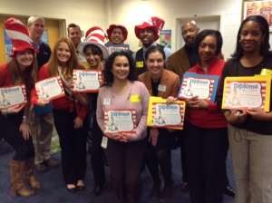 Staff members pose with their diplomas from Read Across America