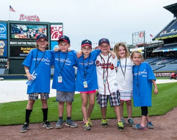 ATLANTA, GA - MAY 12: Connor gets to meet Atlanta Braves players including Gordon Beckham, Mallex Smith and manager Fredi Gonzalez as part of his Make A Wish visit before the game against the Philadelphia Phillies at Turner Field on May 12, 2016 Atlanta, Georgia. (Photo by Kyle Hess/Beam/Atlanta Braves/Getty Images) *** Local Caption ***