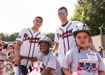ATLANTA, GA - May 25: Surprise Bike Giveaway at Argyle Elementary on May 25, 2016 in Atlanta, Georgia. (Photo by Isaac Green/Beam/Atlanta Braves/Getty Images) *** Local Caption *** Daniel Castro;Reid Brignac