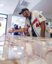 ATLANTA, GA - JUNE 11: Fans look at memorabilia before the game against the Chicago Cubs at Turner Field on June 11, 2016 in Atlanta, Georgia. The Cubs won 8-2. (Photo by Kyle Hess/Beam/Atlanta Braves/Getty Images) *** Local Caption ***