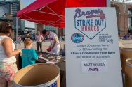ATLANTA, GA - SEPTEMBER 9: Strike Out Hunger with Matt Wisler before the game between the Atlanta Braves against the New York Mets at Turner Field on September 9, 2016 in Atlanta, Georgia. The Mets won 6-4. (Photo by Kyle Hess/Beam/Atlanta Braves/Getty Images) *** Local Caption *** Matt Wisler
